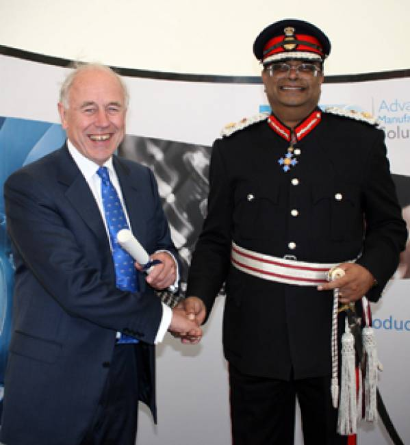 Delcam Chairman, Peter Miles, receives the Award from Her Majesty's Lord-Lieutenant of West Midlands, Paul Sabapathy CBE